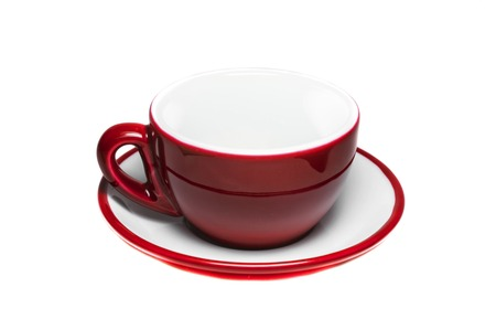 Empty red cup and plate on white background  photo