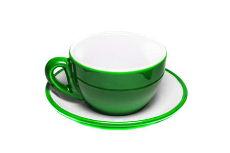 Empty green cup and plate on white background   photo