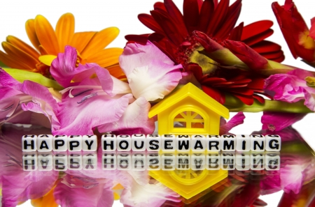 housewarming: Housewarming message with flowers and reflection.