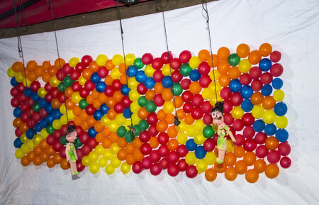 airgun: Popping balloons with air-gun, a popular party and carnival game played for prize.