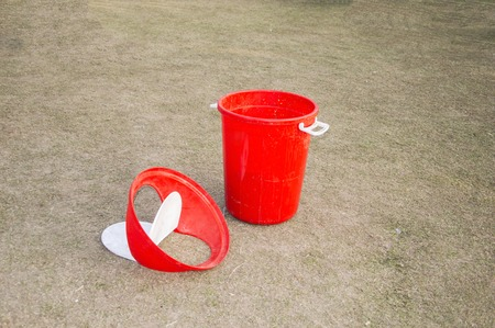 Red waste bucket or dustbin in park  photo