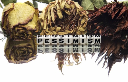 pessimism: Pessimism text message with old and withered flowers.