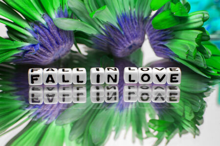 hankering: Fall in love message with green and blue flowers  Stock Photo