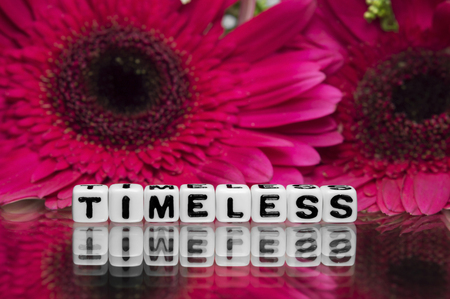 timeless: Timeless text message with pink flowers in the background.