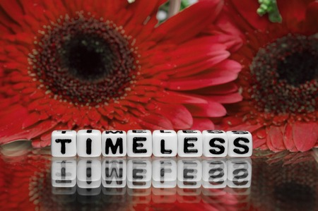 timeless: Timeless text message with red flowers in the background.