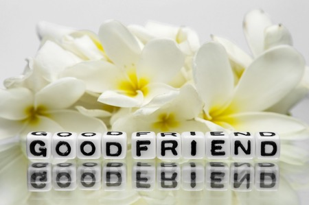 dea: Good friend text message with yellow flowers.
