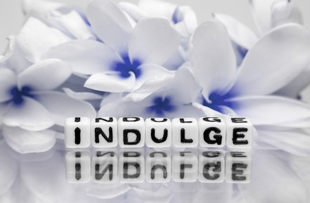 dea: Indulge text message with blue theme and flowers