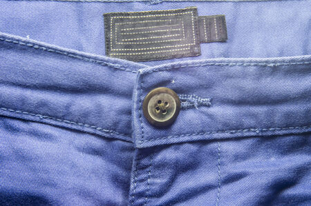 trouser: Blue trouser jeans front side with a big button.  Stock Photo