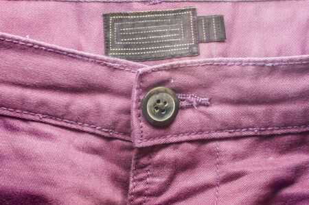 trouser: Pink trouser pant front side with a big button.  Stock Photo