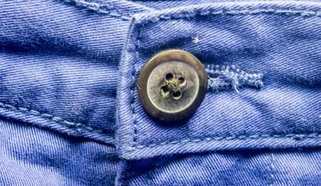trouser: Blue trouser pant close-up with button in the middle.  Stock Photo