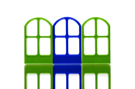 Three gates of green and blue color on white background photo