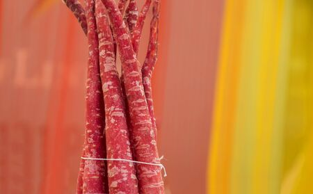 tied together: Bunch of red carrots tied together with thread