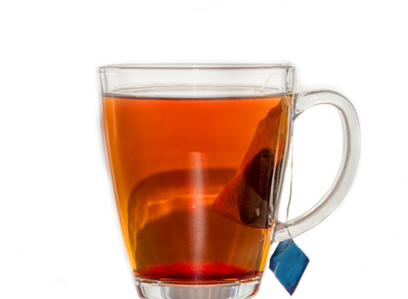 Transparent tea cup with tea and tea bag Stock Photo