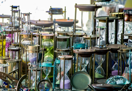 hour glass figure: Multiple hourglasses displayed at a store for sale Stock Photo