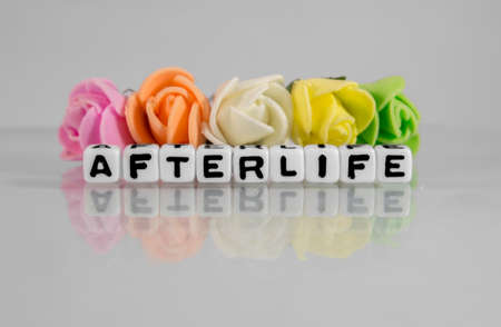 afterlife: Afterlife text message with beads and flowers of different colors.