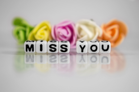 miss: Miss you text message with flowers and beads