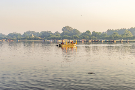 Rowing boat in river with passengers morning time Stock Photo - 47265243