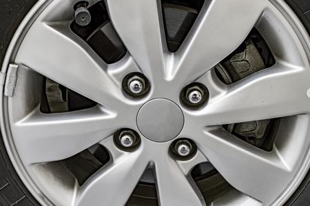 alloy wheel: Chrome alloy wheel cap of car.
