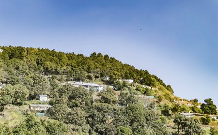 ridges: Homes in mountains of himalayan range. These are small villages on the ridges of slopes of mountains. Stock Photo