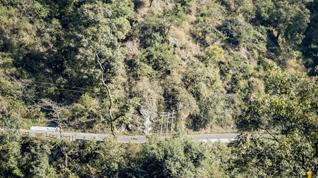 turns: Mountain side road driving with bends and turns. Stock Photo