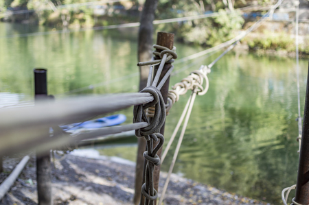 fixed line: Different ropes tied together for adventure sports above lake water.