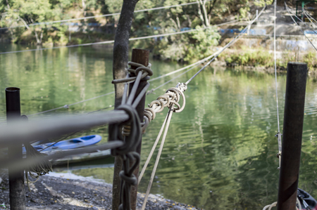 fixed line: Cables across the lake for adventure sports.