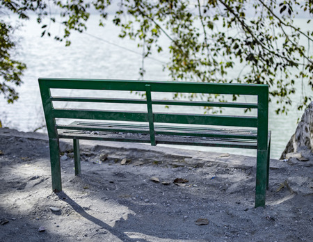 empty bench: Empty bench at water front and lake with nobody.
