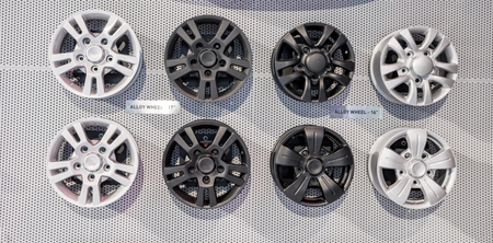 Black and white alloy wheels of different sizes on sale Stock Photo