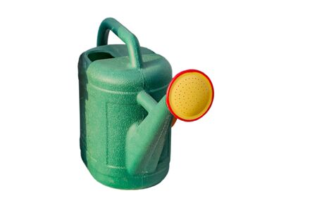 wateringcan: Watering can of green, yellow and red colors on white background