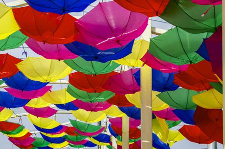 reversed: Multicolored umbrellas reversed hanging in the street.