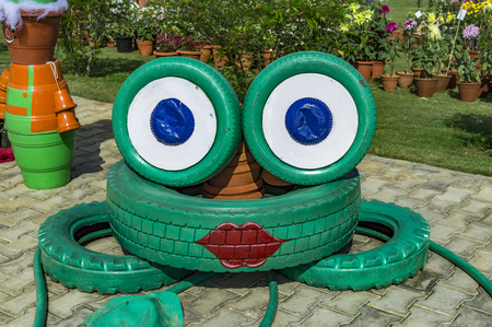 used: Concept art with old used tires to show cartoon figures.