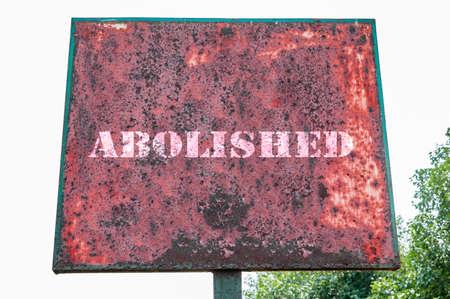 abolished: Abolished text message on signboard.