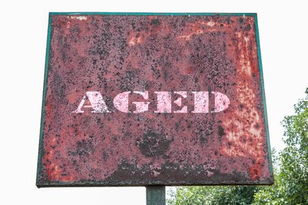abolished: Aged text message on signboard Stock Photo