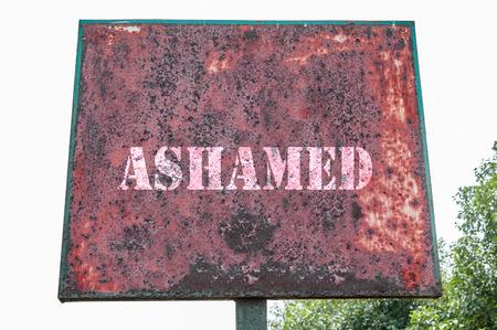 ashamed: Ashamed text message on display on display board.