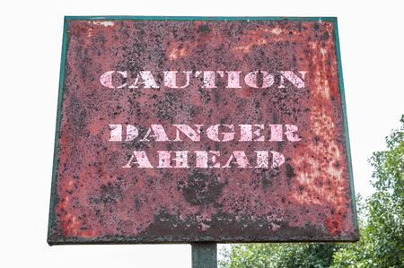 danger ahead: Caution danger ahead text on display board.