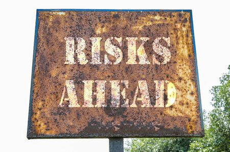 risks ahead: Risks ahead text message on the direction board.