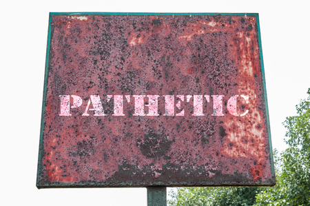 piteous: Pathetic message on the signboard. Stock Photo