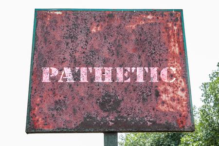 pathetic: Pathetic message on the signboard. Stock Photo