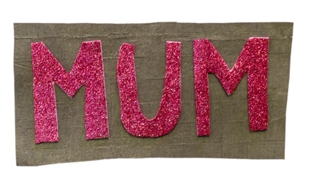 Mum word written with sparkling material of red colors