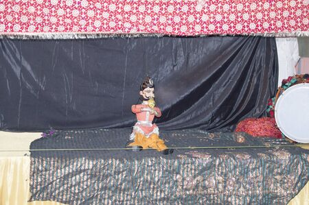 Puppet traditional show with dance and music with threads