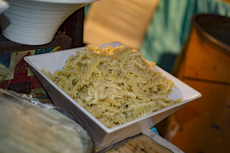 Screw pasta and macaroni boiled in plate for sale at a restaurant