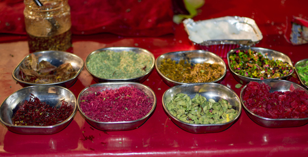 Ingredients for paan masala sweets in plates for sale Stockfoto