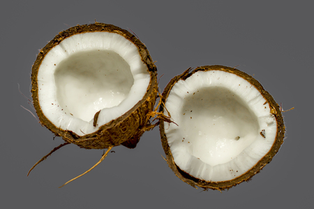Coconut broken and cut in two parts