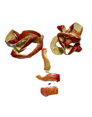 Design of face with apple peelings and seeds Stock Photo