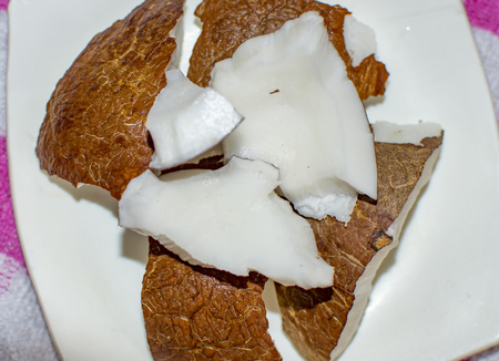 Coconut parts and pieces with white and brown skin Stock Photo