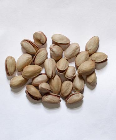 Pile of pistachio on white surface Stock Photo