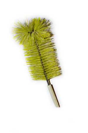 Yellow bottle brush with threads and bristles along with wire handle