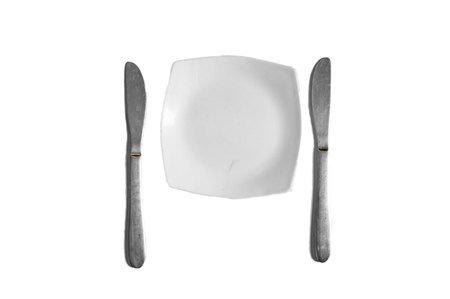 Two Knives and a white plate for serving food