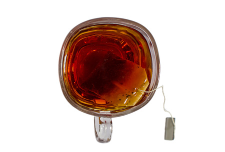 Glass tea cup with bag and thread along with liquid