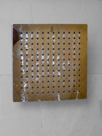 Square shower head in washroom for bath and cleaning